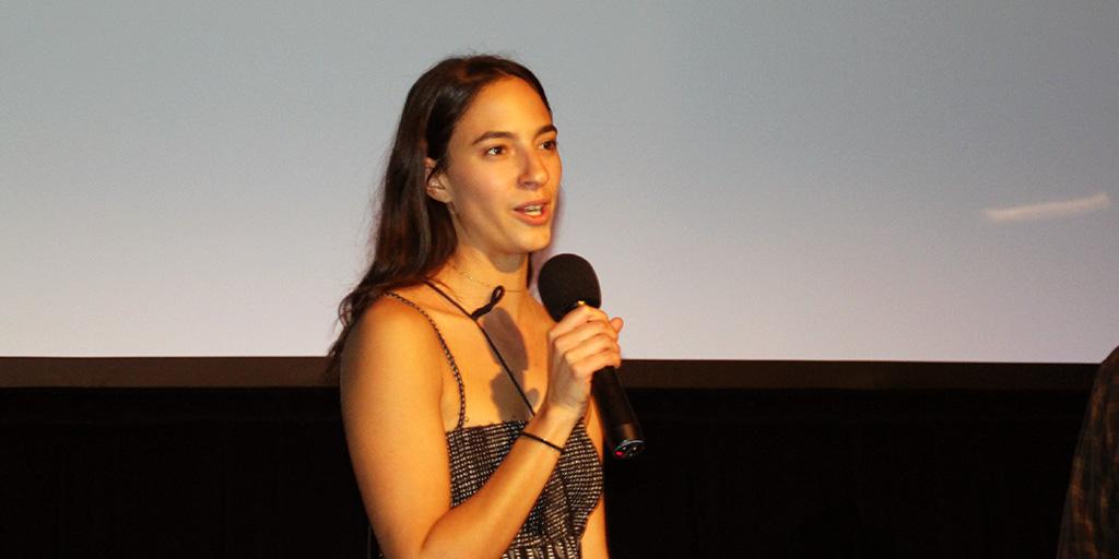 Andrea Cordoba accepting the Grand Chameleon Award.