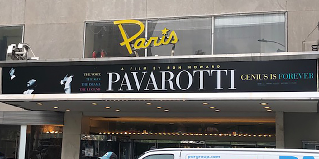 Paris Theatre with Pavarotti on the marquee. June 2019
