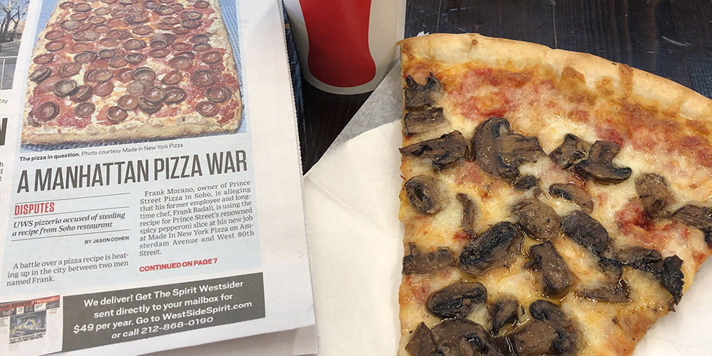 A copy of the West Side Spirit and slice of the good stuff at Made In New York Pizza.