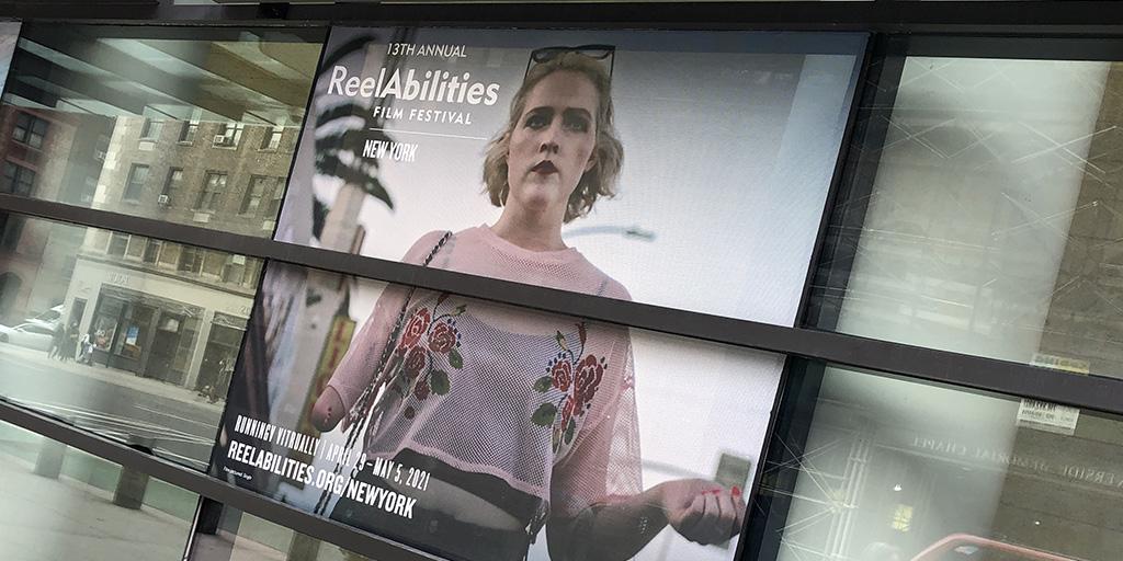 Festival poster for the ReelAbilities Film Festival displayed at the Marlene Meyerson JCC in Manhattan.