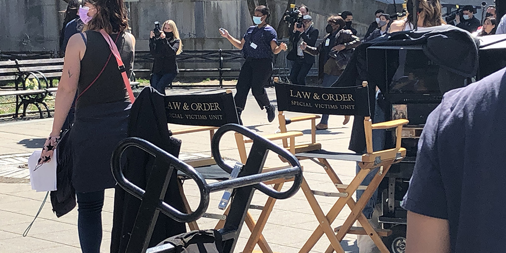 Crew and actors filming Law & Order Special Victims Unit in front of the New York County Supreme Court building.