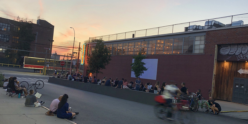 Movie goers are socially distanced while waiting for the movie to start on the wall at Syndicated BK. August 22, 2020